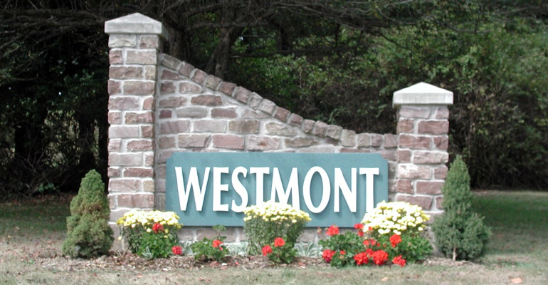 Westmont borough entrance wall with flowers and greenery