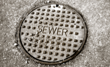 A sewer grate in the road